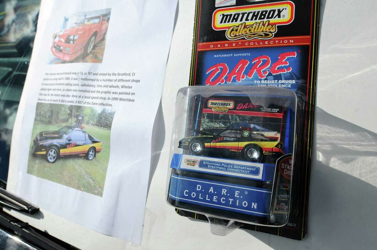 This 1987 Camaro was purchased new, and seized in a drug forfeiture by Stratford, CT police in 1989, and turned into a DARE car. Jack Messore of Mechanicville now owns it. A Matchbox miniature car was made based on the real life version, and both were on display during the second annual Times Union Car Show, a fundraiser for the Times Union Hope Fund, put on by the paper and by In Motion and Rolis Muscle Cars,LLC, on Sunday Sept. 16, 2012 in Colonie, NY. (Philip Kamrass / Times Union)