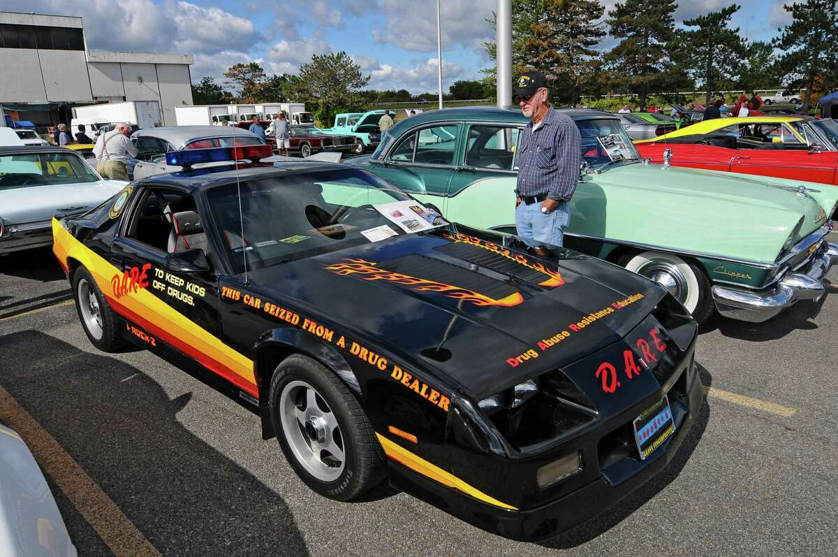 This 1987 Camaro was purchased new, and seized in a drug forfeiture by Stratford, CT police in 1989, and turned into a DARE car. Jack Messore of Mechanicville now owns it. It was on display during the second annual Times Union Car Show, a fundraiser for the Times Union Hope Fund, put on by the paper and by In Motion and Rolis Muscle Cars,LLC, on Sunday Sept. 16, 2012 in Colonie, NY. (Philip Kamrass / Times Union)