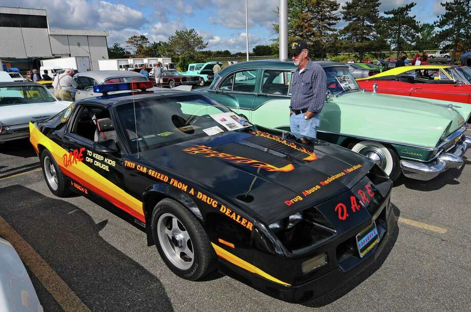 This 1987 Camaro was purchased new, and seized in a drug forfeiture by Stratford, CT police in 1989, and turned into a DARE car. Jack Messore of Mechanicville now owns it.  It was on display during the second annual Times Union Car Show, a fundraiser for the Times Union Hope Fund, put on by the paper and by In Motion and Rolis Muscle Cars,LLC, on Sunday Sept. 16, 2012 in Colonie, NY.   (Philip Kamrass / Times Union) Photo: Philip Kamrass / 00019237A