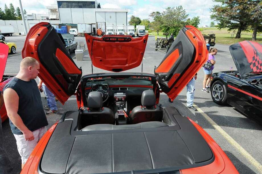 "Steven Roy of Schodack brought this 2011 SS/RS Camaro with scissor doors to the second annual Times Union Car Show, a fundraiser for the Times Union Hope Fund, put on by the paper and by In Motion and Rolis Muscle Cars,LLC, on Sunday Sept. 16, 2012 in Colonie, NY. Roy calls its an everyday driving car, adding, ""It's my sanity.""  (Philip Kamrass / Times Union) Photo: Philip Kamrass / 00019237A"