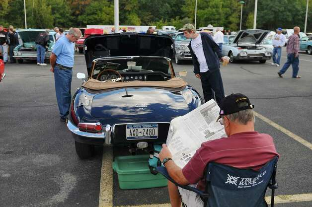 Ray Puffer, foreground,  brought this 1967 Jaguar E-Type 4.2 to the second annual Times Union Car Show, a fundraiser for the Times Union Hope Fund, put on by the paper and by In Motion and Rolis Muscle Cars,LLC, on Sunday Sept. 16, 2012 in Colonie, NY.  (Philip Kamrass / Times Union) Photo: Philip Kamrass / 00019237A