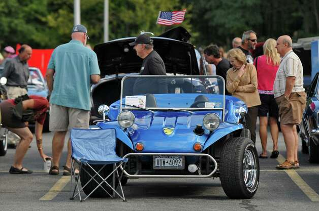Emile Catricala brought this 1968 VW dune buggy, a kit car, to the second annual Times Union Car Show, a fundraiser for the Times Union Hope Fund, put on by the paper and by In Motion and Rolis Muscle Cars,LLC, on Sunday Sept. 16, 2012 in Colonie, NY.  (Philip Kamrass / Times Union) Photo: Philip Kamrass / 00019237A