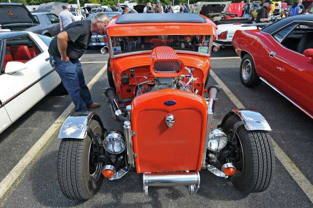 Gene LoVullo of Rensselaer brought this 1930 Ford Coupe, with a 350 Corvette engine from 1969, to the second annual Times Union Car Show, a fundraiser for the Times Union Hope Fund, put on by the paper and by In Motion and Rolis Muscle Cars,LLC, on Sunday Sept. 16, 2012 in Colonie, NY.  (Philip Kamrass / Times Union) Photo: Philip Kamrass / 00019237A