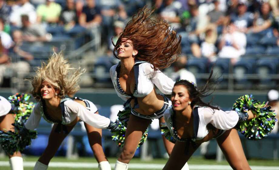 The Sea Gals flip their hair as they perform during halftime at the Seahawks vs Cowboys game at CenturyLink Field on Sunday, September 16, 2012. The Seahawks, playing to a crowd of 68,000, won easily with a score of 7-27. Photo: LINDSEY WASSON / SEATTLEPI.COM