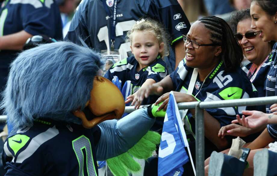 Seahawks mascot Blitz works the crowd during the Seahawks vs Cowboys game at CenturyLink Field on Sunday, September 16, 2012. The Seahawks, playing to a crowd of 68,000, won easily with a score of 7-27. Photo: LINDSEY WASSON / SEATTLEPI.COM