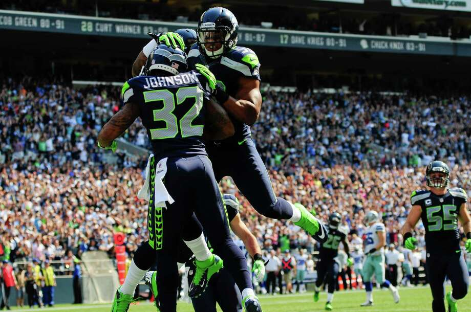 Other players celebrate Jeron Johnson's touchdown for the Seahawks, bringing the score to 0-10, during the Seahawks vs Cowboys game at CenturyLink Field on Sunday, September 16, 2012. The Seahawks, playing to a crowd of 68,000, won easily with a score of 7-27. Photo: LINDSEY WASSON / SEATTLEPI.COM