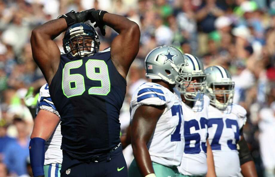 Defensive tackle Clinton McDonald flexes his arms as he riles up the crowd during the Seahawks vs Cowboys game at CenturyLink Field on Sunday, September 16, 2012. The Seahawks, playing to a crowd of 68,000, won easily with a score of 7-27. Photo: LINDSEY WASSON / SEATTLEPI.COM