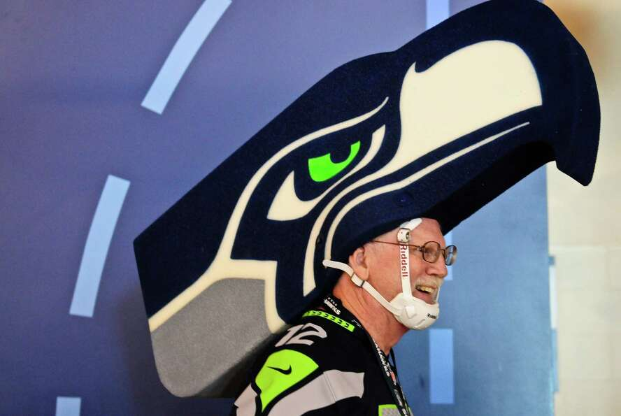 Bob McLaughlin encourages passing Seahawks fans on the ground floor before the Seahawks vs Cowboys g