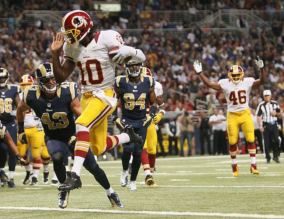 Robert Griffin III had some highlights for the Redskins, such as this 5-yard run, but the Rams came away with the victory. Photo: Chris Lee, Associated Press