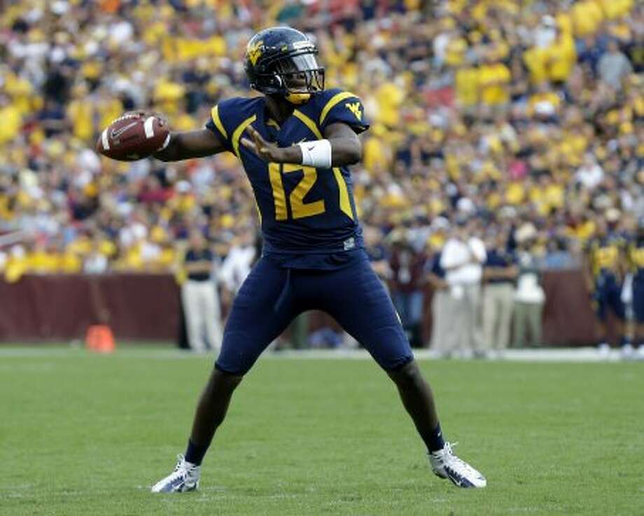 Geno Smith, West Virginia, 34-39-0, 411 yards, 5 TDs. (Alex Brandon / Associated Press)