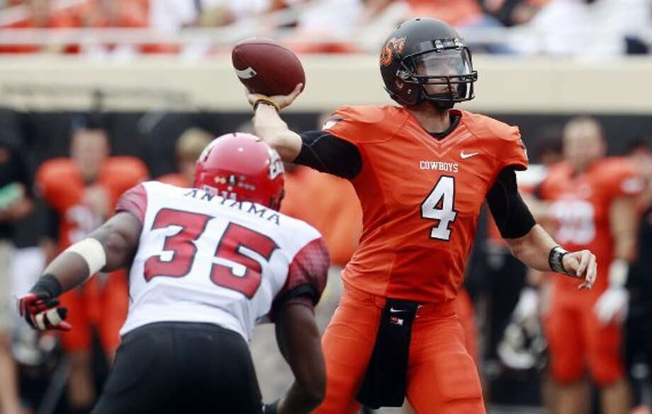 J.W. Walsh, Oklahoma State, 21-30-0, 347 yards, 4 TDs. (Sue Ogrocki / Associated Press)