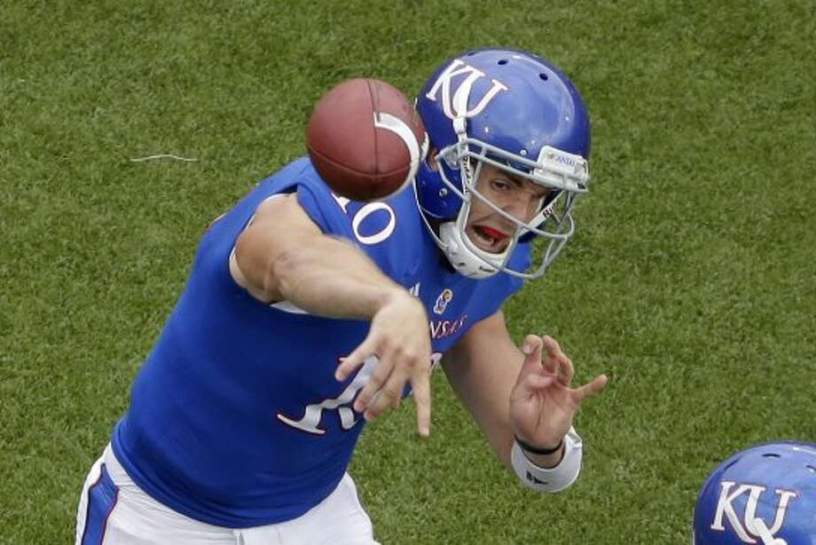 Dayne Crist, Kansas, 19-39-1, 303 yards, 0 TDs. (Charlie Riedel / Associated Press)