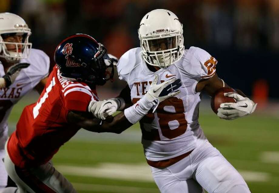 Malcolm Brown, Texas, 21 carries, 128 yards, 2 TDs.  (Scott Halleran / Getty Images)