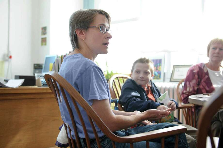 Stacy Fleming of Ballston Spa talks about feeding her son Sheldon, right, 10, through tubes during an interview at the Oley Foundation offices at Albany Med on Tuesday, Sept. 11, 2012 in Albany, NY.  The foundation assists families and individuals that have to get all their nutrition through stomach tubes or veins.   (Paul Buckowski / Times Union) Photo: Paul Buckowski