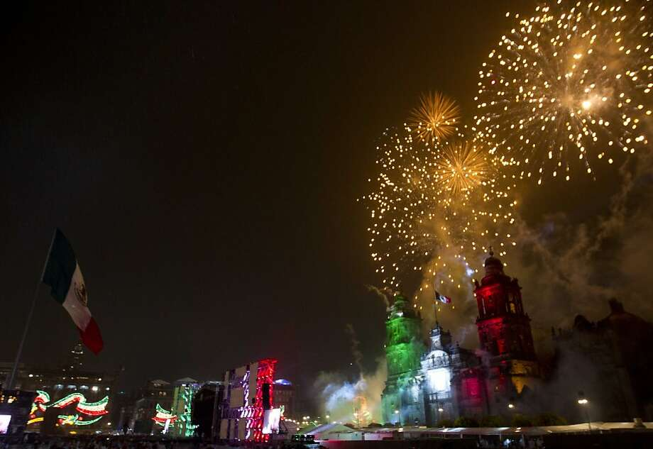 "Fireworks explode over the Metropolitan Cathedral for Independence Day celebrations at the Zocalo in Mexico City, late Thursday, Sept. 15, 2011. Mexico is marking the 202nd anniversary of the ""Grito de Dolores,"" honoring the call to arms made by the priest Miguel Hidalgo in 1810 that began the struggle for independence from Spain, achieved in 1821. (AP Photo/Eduardo Verdugo) Photo: Eduardo Verdugo, Associated Press"