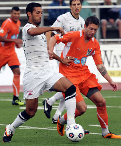 Scorpions' Jonathan Greenfield and RailHawks' Brian Shriver struggle for control of the ball during first half action Sunday Sept. 16, 2012 at Heroes Stadium. Photo: Edward A. Ornelas, Express-News / © 2012 San Antonio Express-News