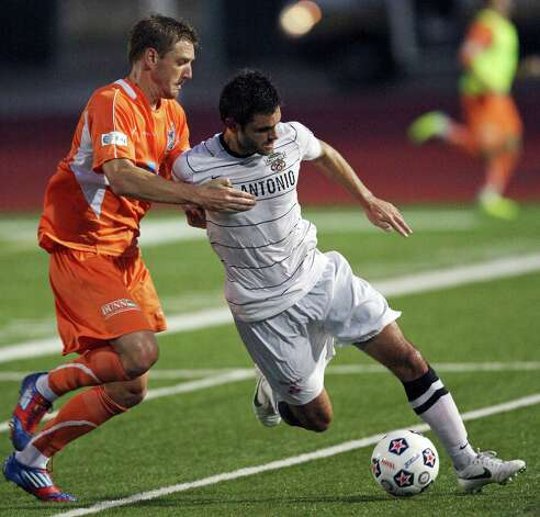 Scorpions' Blake Wagner and RailHawks' Floyd Franks go after the ball during second half action Sunday Sept. 16, 2012 at Heroes Stadium. The RailHawks won 2-1. Photo: Edward A. Ornelas, Express-News / © 2012 San Antonio Express-News