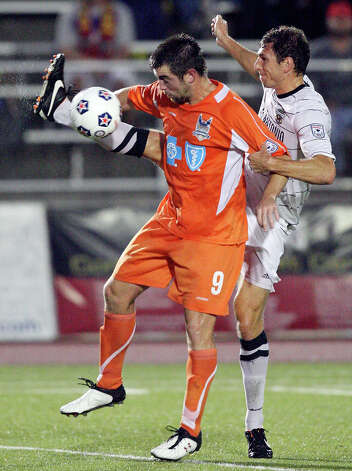 Scorpions' Aaron Pitchkolan and RailHawks' Jason Garey go after the ball during second half action Sunday Sept. 16, 2012 at Heroes Stadium. The RailHawks won 2-1. Photo: Edward A. Ornelas, Express-News / © 2012 San Antonio Express-News