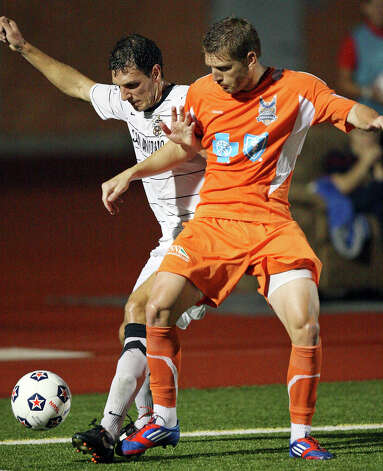 Scorpions' Aaron Pitchkolan and RailHawks' Floyd Franks struggle for control of the ball during second half action Sunday Sept. 16, 2012 at Heroes Stadium. The RailHawks won 2-1. Photo: Edward A. Ornelas, Express-News / © 2012 San Antonio Express-News