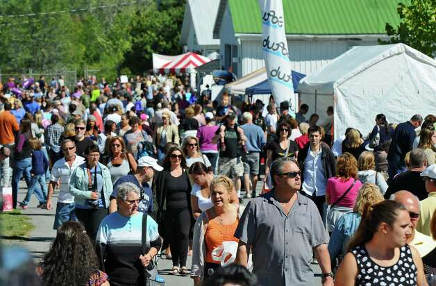 Visitors to the 20th annual Capital Region Apple & Wine Festival at the Altamont Fairgrounds, on Sunday Sept. 16, 2012 in Altamont, NY.   (Philip Kamrass / Times Union) Photo: Philip Kamrass / 00019231A