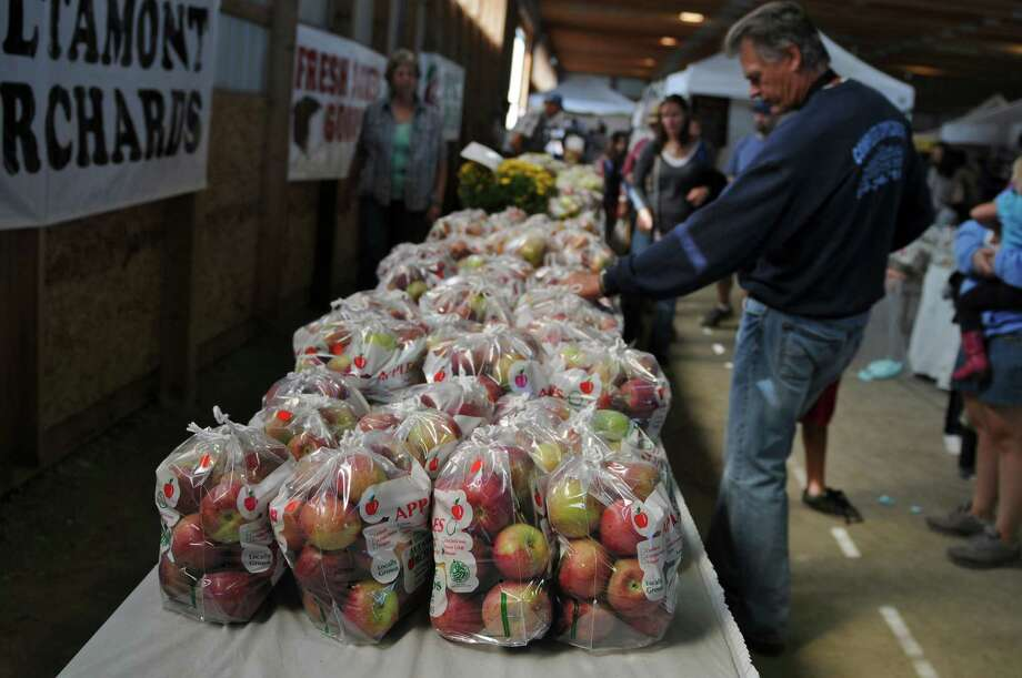 Apples from Altamont Orchards are for sale during the 20th annual Capital Region Apple & Wine Festival at the Altamont Fairgrounds, on Sunday Sept. 16, 2012 in Altamont, NY.   (Philip Kamrass / Times Union) Photo: Philip Kamrass / 00019231A