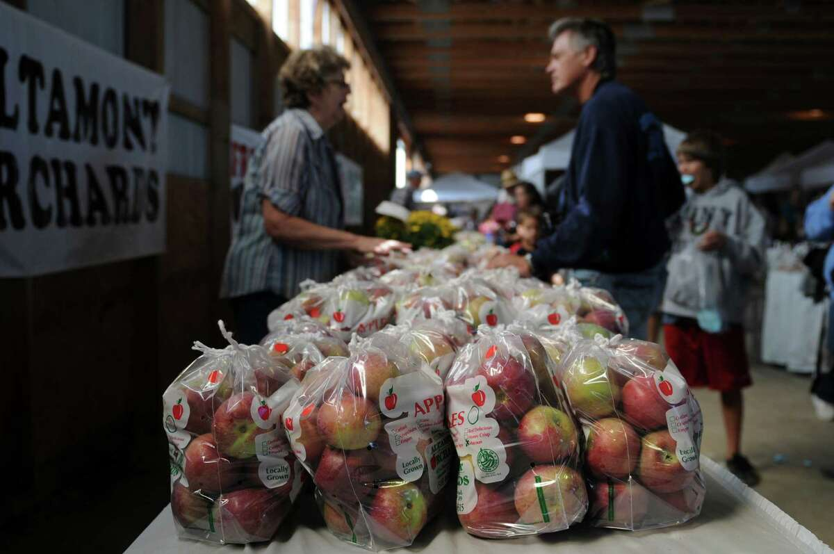 Apples from Altamont Orchards are for sale during the 20th annual Capital Region Apple & Wine Festival at the Altamont Fairgrounds, on Sunday Sept. 16, 2012 in Altamont, NY. (Philip Kamrass / Times Union)
