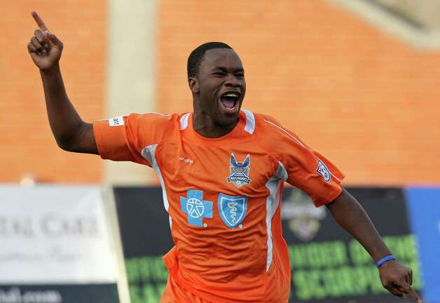 RailHawks' Gale Aqbossoumonde celebrates after scoring a goal against the Scorpions during first half action Sunday Sept. 16, 2012 at Heroes Stadium. Photo: Edward A. Ornelas, Express-News / © 2012 San Antonio Express-News
