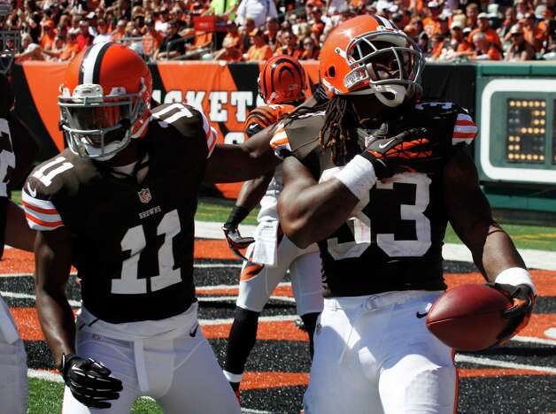 Cleveland Browns running back Trent Richardson (33) celebrates with wide receiver Mohamed Massaquoi (11) after Richardson scored a touchdown against the Cincinnati Bengals, Sunday, Sept. 16, 2012, in Cincinnati. (AP Photo/Tom Uhlman) Photo: Tom Uhlman, Associated Press / FR31154 AP