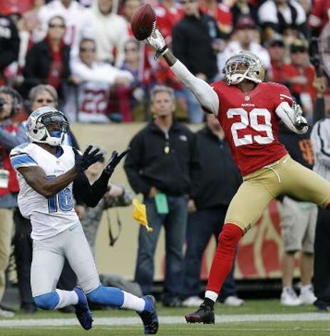 San Francisco 49ers defensive back Chris Culliver, right, breaks up a pass intend for Detroit Lions wide receiver Titus Young, left, during the first quarter of an NFL football game in San Francisco, Sunday, Sept. 16, 2012. A pass interference penalty was called on the play. (Marcio Jose Sanchez / Associated Press)