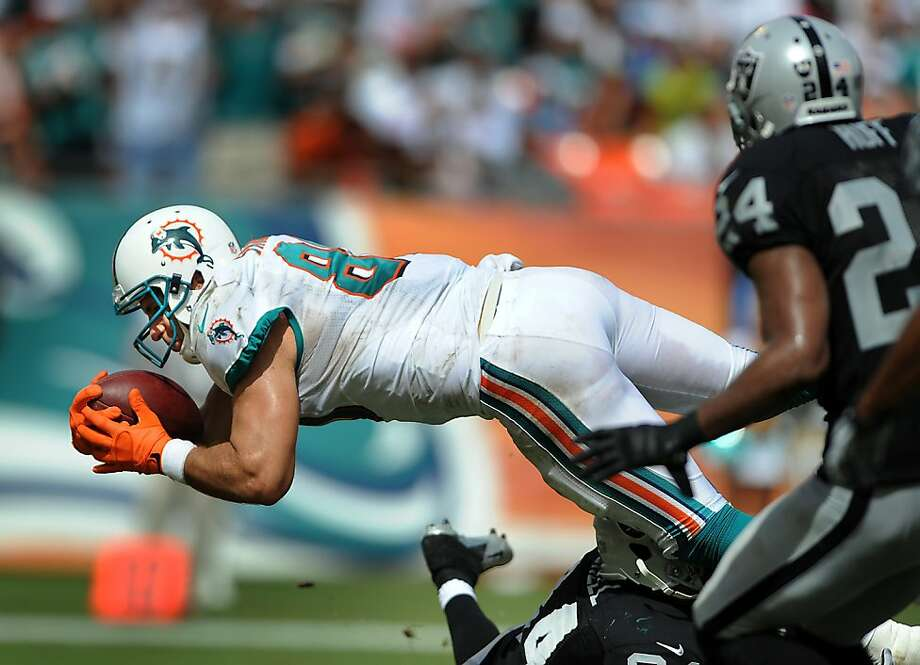 Dolphins' tight end Anthony Fasano dives into the endzone for a fourth quarter touchdown. The Miami Dolphins defeated the Oakland Raiders, 35-13, at Sun Life Stadium in Miami Gardens, Florida, on Sunday, September 16, 2012. (Robert Duyos/Sun Sentinel/MCT) Photo: Robert Duyos, McClatchy-Tribune News Service