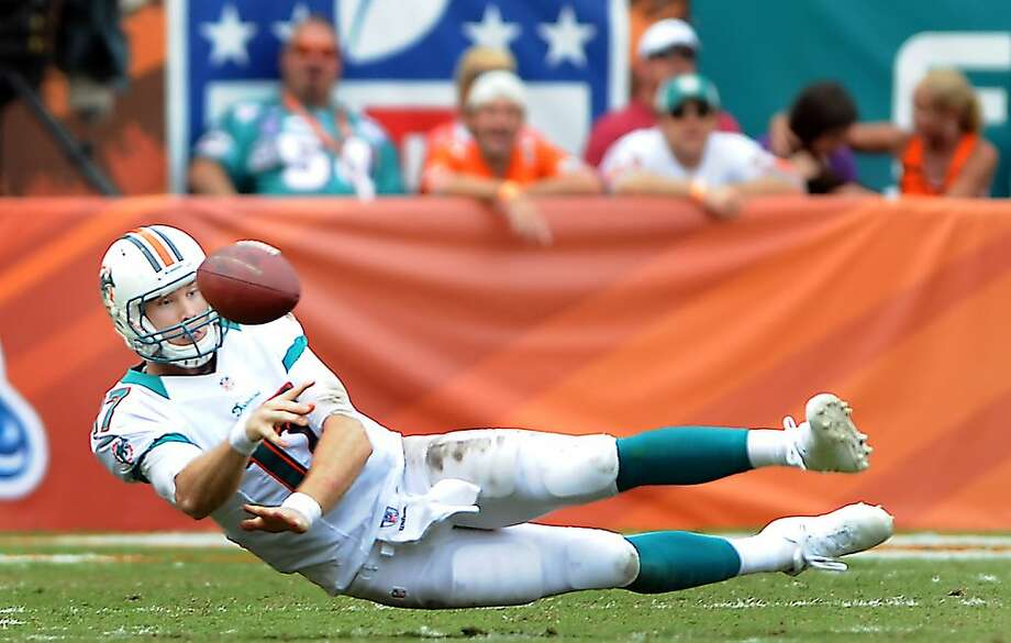 Ryan Tannehill of Miami gets off a pass to Reggie Bush in the first quarter. The Miami Dolphins defeated the Oakland Raiders, 35-13, at Sun Life Stadium in Miami Gardens, Florida, on Sunday, September 16, 2012. (Robert Duyos/Sun Sentinel/MCT) Photo: Robert Duyos, McClatchy-Tribune News Service