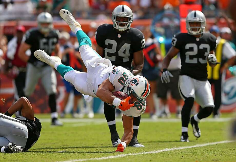 Anthony Fasano #80 of the Miami Dolphins dives for a touchdown during a game against the Oakland Raiders at Sun Life Stadium on September 16, 2012 in Miami Gardens, Florida.  (Photo by Mike Ehrmann/Getty Images) Photo: Mike Ehrmann, Getty Images