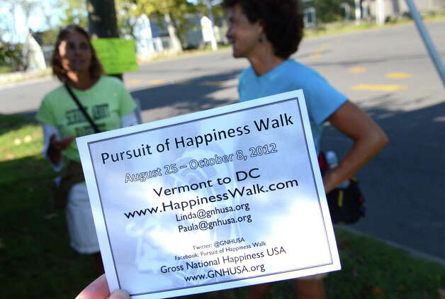 A notecard that Paula Francis, 54, and Linda Wheatley, 53, of Montpelier, VT, hand out to passersby in Stamford on Sunday, Sept. 16, 2012. Francis and Wheatley left Stowe, Vermont on August 25, 2012 on a 560-mile, 44-day walk to Washington, D.C. to raise awareness about the need to adopt happiness and well-being as the ultimate goal of social and political policy. Photo: Amy Mortensen / Connecticut Post Freelance