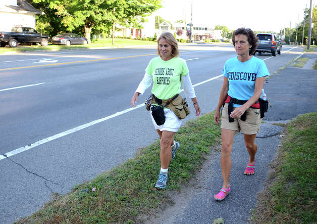 Paula Francis, 54, and Linda Wheatley, 53, of Montpelier, VT, walk along High Ridge Road in Stamford on Sunday, Sept. 16, 2012. Francis and Wheatley left Stowe, Vermont on August 25, 2012 on a 560-mile, 44-day walk to Washington, D.C. to raise awareness about the need to adopt happiness and well-being as the ultimate goal of social and political policy. Photo: Amy Mortensen / Connecticut Post Freelance