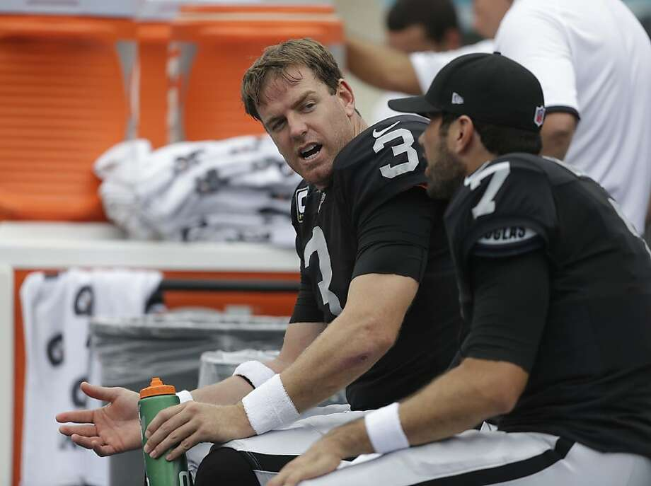 Oakland Raiders quarterback Carson Palmer (3) talks to quarterback Matt Leinart (7) on the sidelines during the first half of an NFL football game,  Sunday, Sept. 16, 2012 in Miami. (AP Photo/Lynne Sladky) Photo: Lynne Sladky, Associated Press