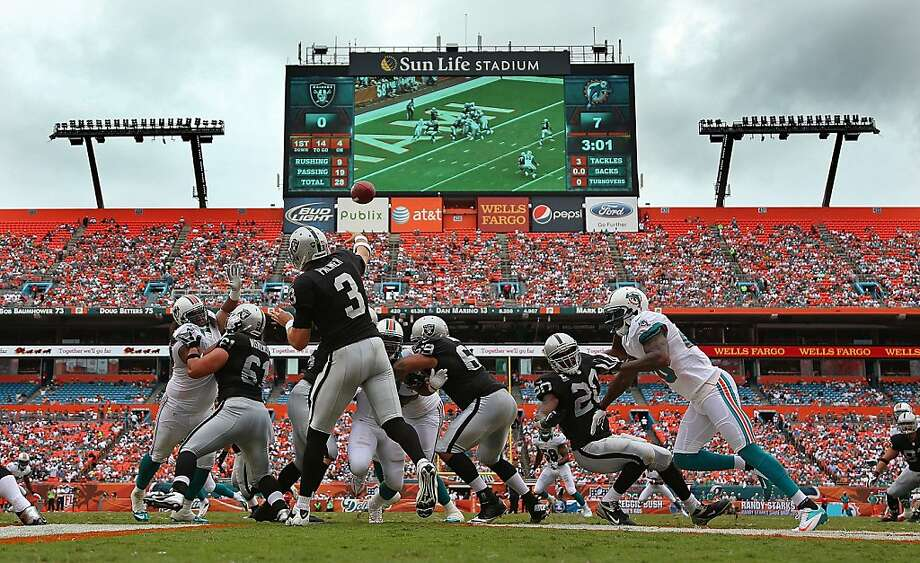 Carson Palmer #3 of the Oakland Raiders passes during a game against the Miami Dolphins at Sun Life Stadium on September 16, 2012 in Miami Gardens, Florida.  (Photo by Mike Ehrmann/Getty Images) Photo: Mike Ehrmann, Getty Images