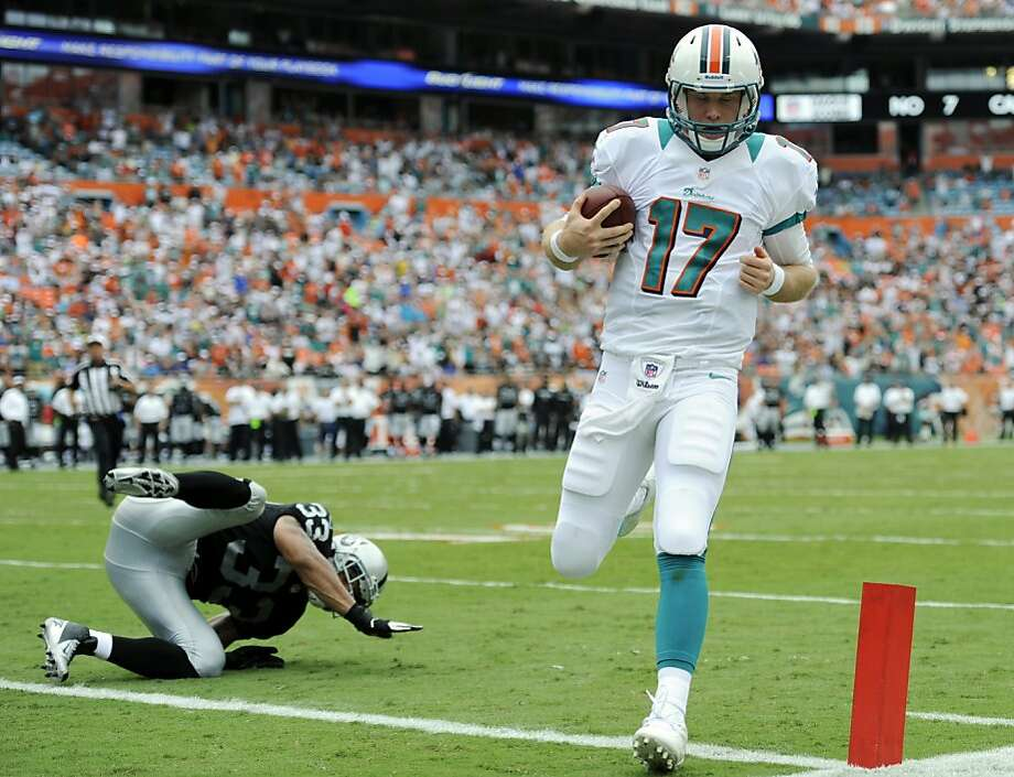 Miami Dolphins quarterback Ryan Tannehill (17) scores a touchdown during the first half of an NFL football game against the Oakland Raiders, Sunday, Sept. 16, 2012, in Miami. (AP Photo/Rhona Wise) Photo: Rhona Wise, Associated Press