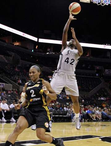 Silver Stars' Shenise Johnson shoots around Shock's Temeka Johnson during second half action Sunday Sept. 16, 2012 at the AT&T Center. The Shock won 80-70. Photo: Edward A. Ornelas, Express-News / © 2012 San Antonio Express-News