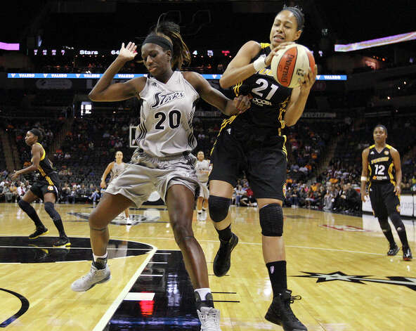 Silver Stars' Shameka Christon and Shock's Jennifer Lacy grab for a rebound during second half action Sunday Sept. 16, 2012 at the AT&T Center. The Shock won 80-70. Photo: Edward A. Ornelas, Express-News / © 2012 San Antonio Express-News