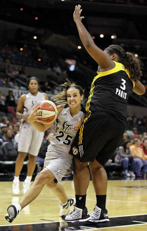 Silver Stars' Becky Hammon drives around Shock's Courtney Paris during second half action Sunday Sept. 16, 2012 at the AT&T Center. The Shock won 80-70. Photo: Edward A. Ornelas, Express-News / © 2012 San Antonio Express-News