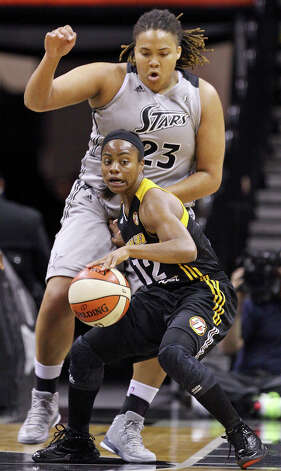 Silver Stars' Danielle Adams defends the Shock's Ivory Latta during first half action Sunday Sept. 16, 2012 at the AT&T Center. Photo: Edward A. Ornelas, Express-News / © 2012 San Antonio Express-News