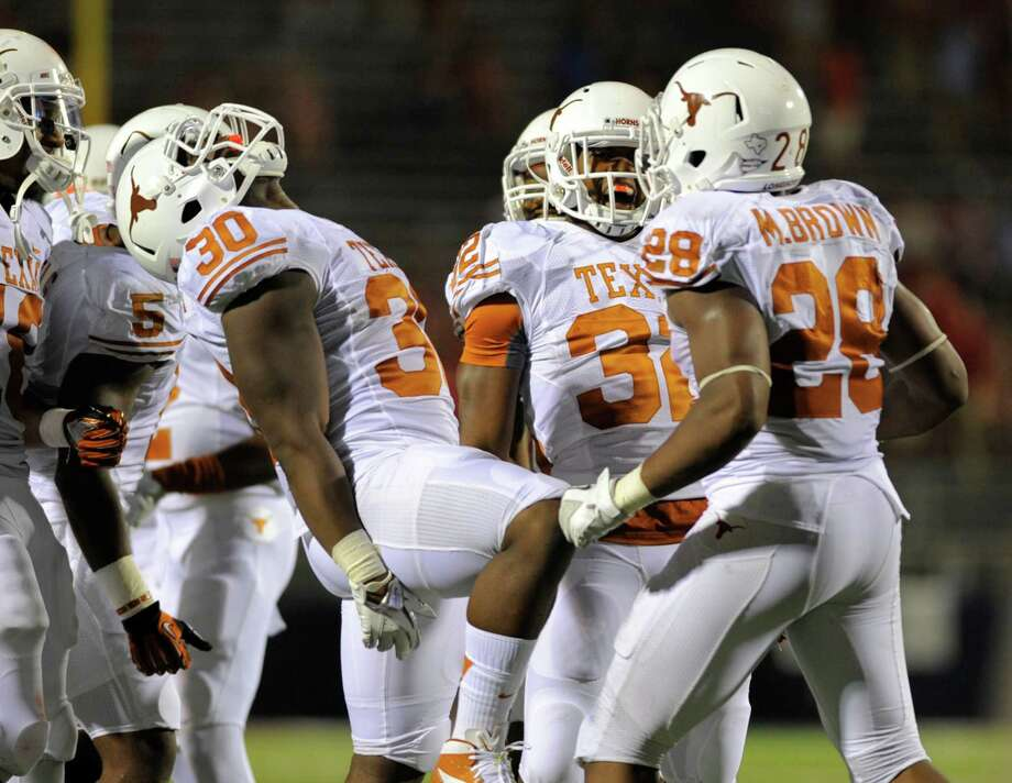 For Ryan Roberson, left, and his fellow Longhorns, Saturday night's game turned into a true laugher. Photo: Austin McAfee / AP