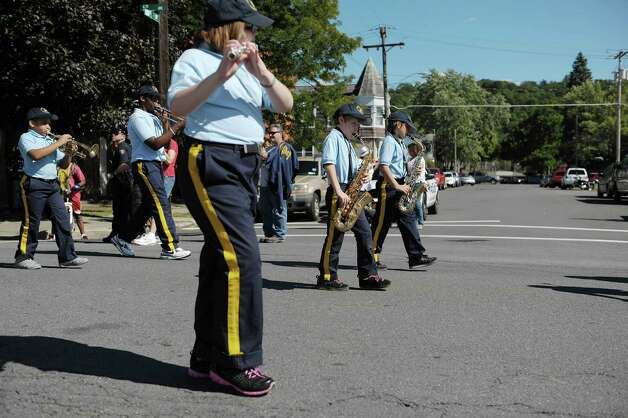 Members of The Father Flanigan Marching Band from St. Augustine's School in Troy perform as they march down Fifth Avenue during the  Uncle Sam Parade on Sunday, Sept. 16, 2012 in Troy, NY.  (Paul Buckowski / Times Union) Photo: Paul Buckowski