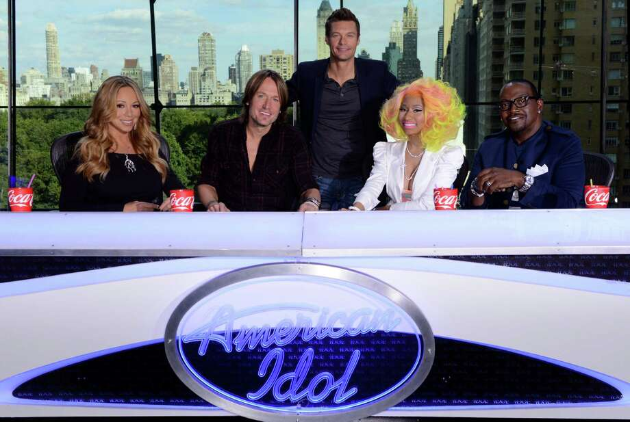 This photo provided by Fox, American Idol host Ryan Seacrest, center, poses with judges, from left, Mariah Carey, Keith Urban, Nicki Minaj and Randy Jackson, Sunday, Sept. 16, 2012 in New York. The Fox network officially announced the addition of Urban and Minaj on Sunday, confirming rumors surrounding them both just hours before the first round of auditions for next season was due to begin in New York. (AP Phioto/Fox, Michael Becker) Photo: Michael Becker