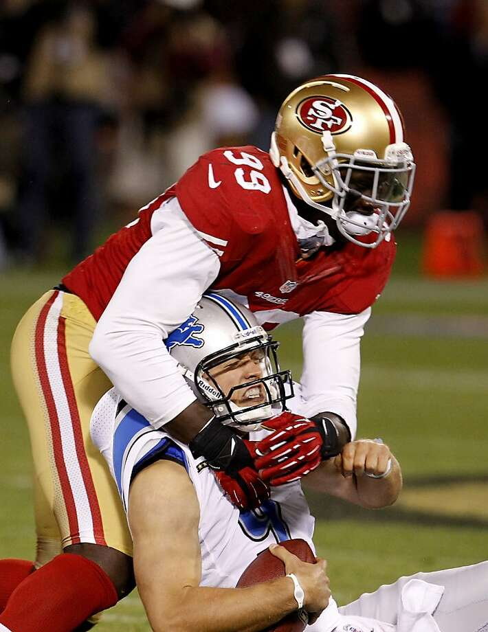 Aldon Smith's sack of Lions quarterback Matthew Stafford was one of the linebacker's impact plays Sunday. Photo: Brant Ward, The Chronicle