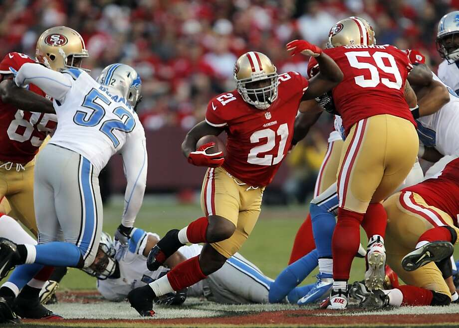 Frank Gore breaks through a hole in the line for a gain in the third quarter. The San Francisco 49ers played the Detroit Lions at Candlestick Park in San Francisco, Calif., on Sunday, September 16, 2012. Photo: Carlos Avila Gonzalez, The Chronicle