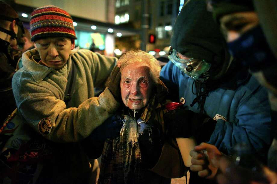 "Monday, September 17th is the one year anniversary of the start of the Occupy Wall Street movement. Here is a look back at Occupy's Seattle offshoot: Activist Dorli Rainey, 84, is helped by fellow Occupy Seattle protestors after being hit with pepper spray during a protest on Tuesday, November 15, 2011. After asking protestors to move to the sidewalk, police doused protestors with what Rainey later described as ""a fountain of pepper spray."" Other protesters splashed a milky-solution in Rainey's face to reduce the sting of the chemical irritant. The incident sparked international outrage, a review of the department's response to the protest, and an apology from Seattle Mayor Mike McGinn. It also became one of the notable incidents of the Occupy movement. Photo: JOSHUA TRUJILLO / SEATTLEPI.COM"