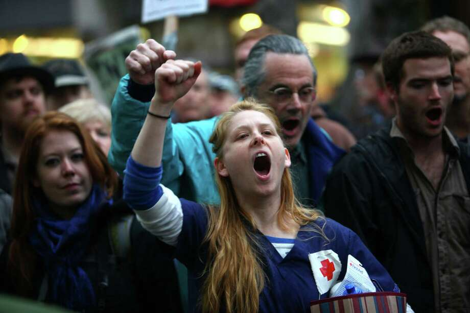 Protesters chant as people are arrested during an Occupy Seattle protest at Westlake Park on Wednesday, October 5, 2011. The protests in Seattle mirrored the Occupy Wall Street protest in New York, taking over a downtown park. Protesters in Seattle were ordered to remove their encampment from the park, leading to arrests of dozens of people that refused to move. Photo: JOSHUA TRUJILLO / SEATTLEPI.COM