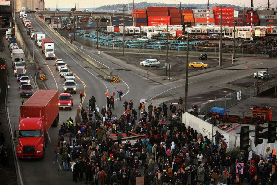 Protesters man a barricade blocking entry to the Port of Seattle on Monday, December 12, 2011. Hundreds of anti-Wall Street protesters gathered at the port and tried to shut down operations. Protesters scuffled with police during the rally and police used pepper spray and two flash-bang grenades to disperse the crowd after a protester threw a lit road flare toward officers. Another threw red paint on officers. Photo: JOSHUA TRUJILLO / SEATTLEPI.COM
