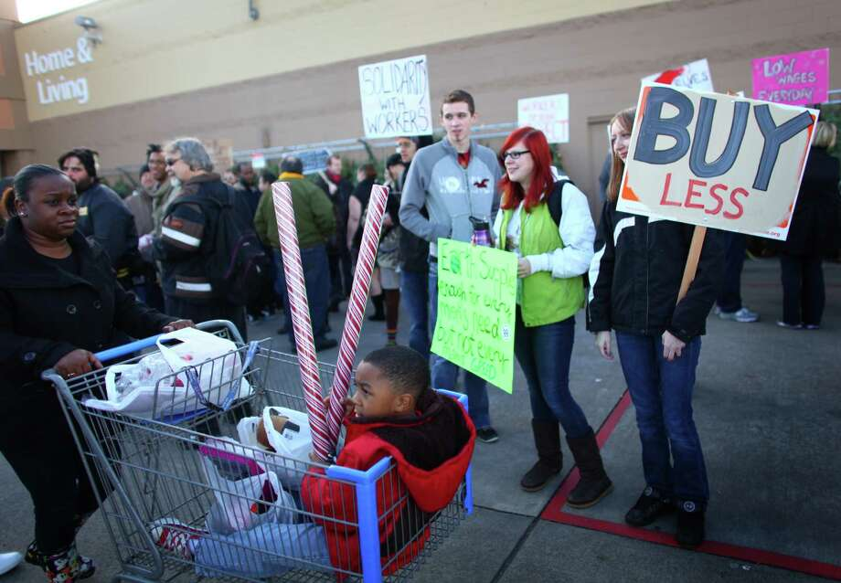 Protesters gather in front of Walmart in Renton during an Occupy Seattle protest at the retailer on Friday, November 25, 2011. A few dozen protesters gathered in front of the store and briefly marched through the store during the Black Friday protest. Photo: JOSHUA TRUJILLO / SEATTLEPI.COM